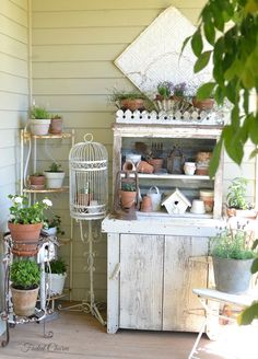 I have an old wooden cabinet like this sitting in the basement and I've been trying to convince my hubby to let me use it outside like this!