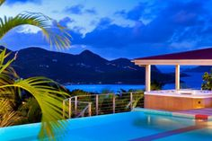 Hillside in St. Jean, this fully air-conditioned three bedroom, three and a half bathroom luxury villa is contemporary in design with a colorful tropical decor