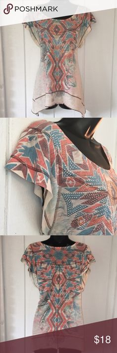 """🎱Free People - Tribal Print Shark Bite Top Free People - Lightweight and flowing shark bite silhouette with tribal print and sparkling accents. Shows beginning signs of wear. Please examine photos as they are part of the description. Bust = 18"""" and length from shoulder to hem is 25"""". Smoke free home. Check out my bundle discount! Free People Tops"""