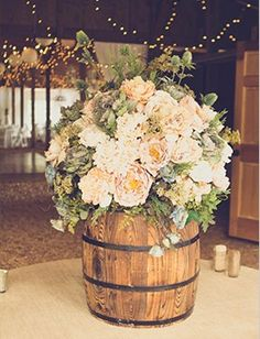 Mini barrels for table centerpieces...too cute!