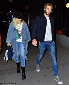 Fashionable:Miley looked stylish as she was dressed in double denim including a long duster and skinny jeans