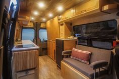 This van conversion was built for taking extended weekend trips, with a double drop down bed, large kitchen galley, and a modular bench seat with a dog bed. Van Conversion Interior, Camper Van Conversion Diy, Tiny House Big Living, Rv Living, Small Living, Motorhome, Build A Camper Van, Campervan Interior, Van Camping