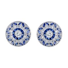 A pair of sapphire and diamond set earrings, mounted in an 18ct white gold setting.