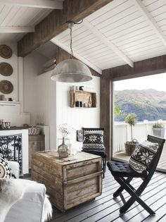 Neutral living room overlooking the water - Scandinavian design - Wabi Sabi - Nordic fabrics