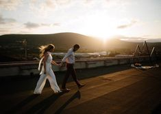 Sunset strolling in our Ivory Soho Jumpsuit 🌄  A modern twist on bridalwear and available in all of our colours, our Soho is perfect for both the bride and bridesmaids ✨  Photography :  Stockist : Backdrop :    Ivory Bridesmaid Dresses, Brides And Bridesmaids, Wedding Looks, Bridal Looks, Planning A Small Wedding, Bridal Jumpsuit, Irish Wedding, Urban City, Couple Portraits