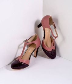 Gatsby always puts us in good spirits, dolls! Presenting a prepossessing pair of captivating charmers, the Gatsby heels - a pair of endearingly matte mauve pink and patent burgundy t-strap pumps with eyelet perforation detail. Featuring a man-made upper,