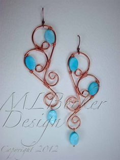 Wire Wrapped Copper Drop Earrings with Aqua Shell Oval Beads. $73.00, via Etsy.