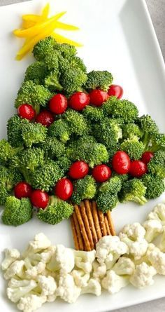 """Tree Vegetable Platter ~ A broccoli and tomato """"tree"""" with a pretzel """"trunk"""" and cauliflower """"snow"""" makes for a memorable and easy Christmas appetizer! MoreChristmas Tree Vegetable Platter ~ A broccoli an. Christmas Snacks, Xmas Food, Christmas Cooking, Christmas Goodies, Holiday Treats, Holiday Recipes, Christmas Dinners, Christmas Tree Veggie Tray, Holiday Foods"""