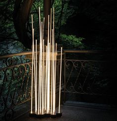 Inspired by nature, the Artemide Reed LED Floor Lamp features 7 transparent rods that capture the warmth of the integrated LEDs. A stunning outdoor lighting statement. Contemporary Outdoor Lighting, Contemporary Light Fixtures, Landscape Lighting, Contemporary Style, Contemporary Furniture, Outdoor Floor Lamps, Led Floor Lamp, Outdoor Flooring, Led Lamp