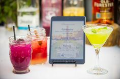 Vibrant Cocktail Drinks in Assorted Glassware with iPad Menu | Photography: Michael Svoboda. Read More: https://www.insideweddings.com/news/planning-design/watch-an-outdoor-event-be-built-from-the-ground-up/3115/