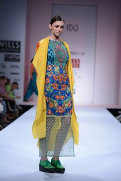 JENJUM GADI AT WILLS INDIA LIFESTYLE  Jenjum Gadi presented us with a colorful tale of textures and silhouettes at Wills India Fashion Week. Shop his previous collection at http://www.perniaspopupshop.com/designers-1/jenjum-gadi #jenjumgadi #amazing #willsindiafashionweek #fashionweek #delhi #designer #dress