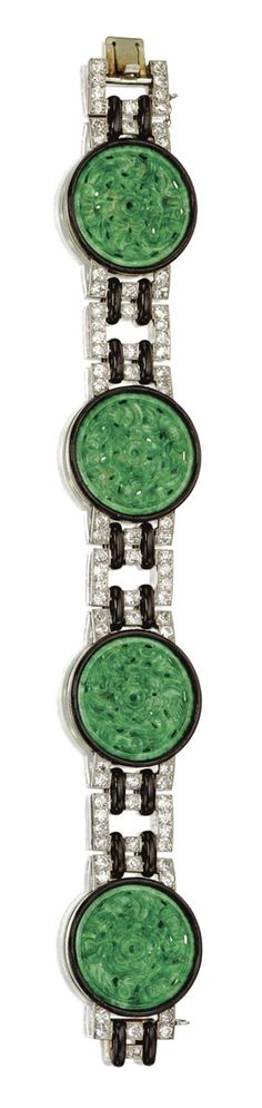CARVED JADEITE, DIAMOND AND ENAMEL BRACELET, FRENCH, CIRCA 1920 Composed of four circular jadeite plaques carved and pierced in floral motifs, rimmed in black enamel, connected by segments of rectangular links set with a total of 82 old European-cut diamonds weighing approximately 5.00 carats, joined by black enamel bands, mounted in platinum and gold, length 7 inches, French assay marks.  With fitted box.