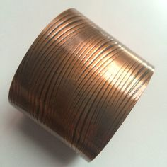 This copper cuff is designed with beautiful lines that accentuates any look you may be going for. $50