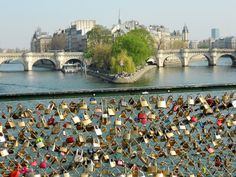 Love Lock Bridge in Paris. I will return here, with my husband and we will lock our own padlock onto the bridge and throw our key into the river :) Sooo cute