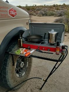 TailGater Tire Table is stable regardless of ground conditions. It has a retractable leg for extra support. Fits most tire sizes and up. Camping Hacks, Camping Bedarf, Truck Bed Camping, Camping Table, Outdoor Camping, Camping Ideas, Camping Survival, Survival Gear, Rv Hacks