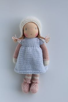Sweet little Marit is available for adoption!  Marit is a little knitted Waldorf inspired doll made in The Netherlands from all natural materials: Swiss cotton knit doll fabric, clean carded wool, eco and fairtrade hand dyed cotton and alpaca yarn and a crocheted curly mohair wig. Her face is hand embroidered and her cheeks are blushed with Stockmar beeswax crayon.  She is about 8 - 10 inch (20 - 25 cm tall). This sweet little doll will become your very best friend.  Marit is handknitted by…