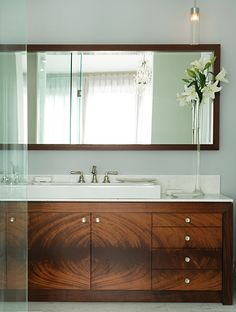 Add a hint of traditional elegance to a vanity with contemporary lines by using decorative crotch mahogany veneer on the face of the cabinet doors. It's the perfect blend for a modern bathroom in a century home.