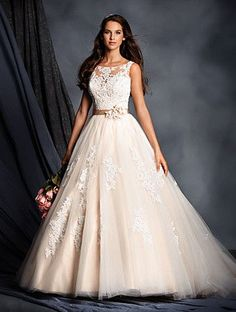 Beaded Lace Yoke Bridal Gown with Ball Gown Skirt A sheer yoke with a sweetheart neckline and low backline decorates this signature wedding dress. Lace is crystal beaded throughout and the full skirt