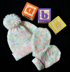 Newborn Scratch Mitts and Matching Beanie - an easy project for a beginning knitter wanting to learn to knit in the round. It uses only the   Garter st (back and forth) and then switches to knitting in the round (knit st only). The project is knitted entirely on double pointed needles.