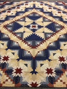 This Eureka quilt done in red white and blue 19th century repros and inspired fabrics by Bergereink