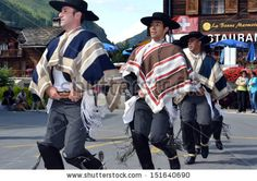 EVOLENE, SWITZERLAND - AUGUST 13: Chilean dancing men at the International Festival of Folklore and Dance from the mountains (CIME) :  August 13, 2013 in Evolene Switzerland - stock photo