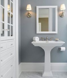 Solitude by Benjamin Moore looks amazing in this bathroom designed by Eminent Interior Design. Solitude is one of of my favorite colors to recommend because it always works beautifully in spaces with little natural light. Put it on your radar for sure! It's a fantastic color! #designinspo #bathroom #paintcolor #benjaminmoore