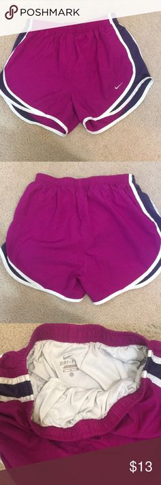 Nike shorts Good condition Nike shorts. Purple color with navy on the mesh. Drawstring has come out of the shorts Nike Shorts