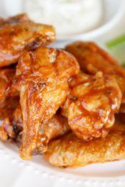MADE THESE! and took them into my husbands work.. They were destroyed. I tripled it and made a buffalo sauce of 1/2 c butter, 1/2 franks red hot.. With adobo sprinkled in with the baking powder. Boom! The secret to Crispy Glazed Chicken Wings in the Oven sm