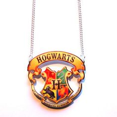 Hogwarts Crest Cut Out Pendant Necklace. Cool Harry Potter Hogwarts school crest inspired large pendant, printed and laser cut from 3mm acrylic, on split 41cm silver plated curb chain with lobster clasp fastening.  #jewellery #jewelry #boutique #costume #kitsch #quirky #film #movie #book #harrypotter #hogwarts #school #crest #acrylic #necklace #pendant #chain #lasercut #shopping #fun #love