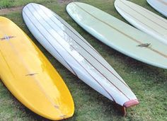 line up of surfboards