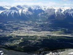 A view of Canmore in the Bow Valley from the summit of Mount Lady MacDonald east of Banff National Park, Alberta, Canada