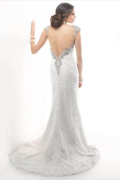 Find at Casa di Bella Bridal Boutique in Celebration, FL   Dazzle in this sensational sheath dress of beaded Chantilly lace with soft, cording detail and bead embroidered trim, accented with Swarovski crystals. Finished with zipper and crystal button closure.