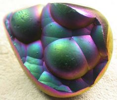 """Agate. You've heard of """"mystic topaz?"""" Well, this is mystic agate.  Treated with vapor deposition to obtain the color effect."""
