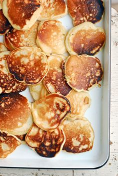 Cook up a perfect fall breakfast with this easy recipe for fluffy apple pancakes made with fresh apples and whole milk yogurt. | Pinterest: Natalia Escaño
