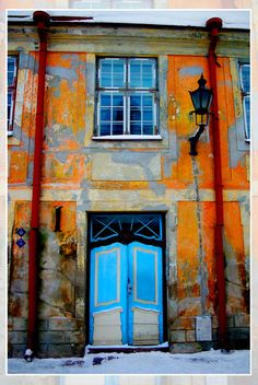 Tallinn, Estonia: Orange building with a blue door #COLOURFULESTONIA #VISITESTONIA