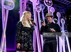 Actors Ashley Benson (L) and Tyler Blackburn speak onstage during the MTV Fandom Fest San Diego Comic-Con at PETCO Park on July 9, 2015 in San Diego, California.