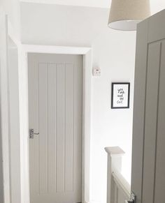 Farrow & Ball Paint – Purbeck Stone Grey is demure, on trend, and works wonderfully to add depth to this white hallway. It gives a modern finish to these vintage style doors and makes for a contemporary cottage look www. Grey Interior Doors, Interior Door Styles, Painted Interior Doors, Grey Doors, Home Interior Design, Cottage Doors Interior, Cottage Style Doors, Paint Doors, White House Interior