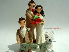 This is cute, you could have Ollie and Ruby on it. Lovely family customized wedding cake topper by Clayphory on Etsy.