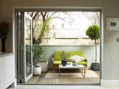 A small terrace off the kitchen, complete with vintage Danish sofa, functions as an outdoor room on dry days.