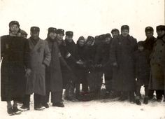 Poland ,Lodz, A group of workers outside the ghetto.