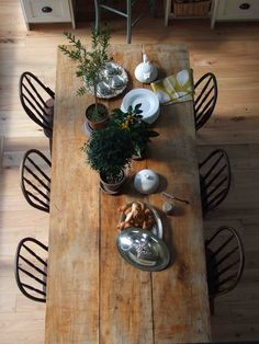 Reclaimed monk's wood table in rustic farmhouse dining design by Carol Reed