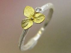 responsibly mined and conflict free Hydrangea blossom diamond ring