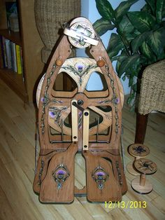This one's really pretty. Ashford Joy 2 spinning wheel Custom Painted by BadfaerieDesigns, $1800.00