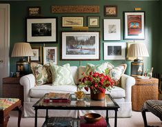 Home Office Dark green walls — Peale Green by Benjamin Moore — are a rich backdrop for the owners' eclectic mix of photographs and art in the home office. A cane coffee table from John Rosselli, woven side tables from Pottery Barn, and the vintage concert poster add to the casual vibe. Ashley Whittaker House Beautiful Feb. 2013