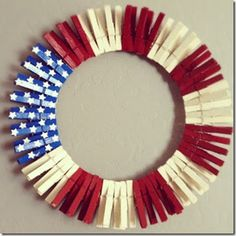 Paint clothes pins red white and blue/stars. Get or make a metal wreath with wire and there you go :) I love this...so easy and messy.