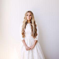 modest wedding dress three quarter sleeves and a full skirt