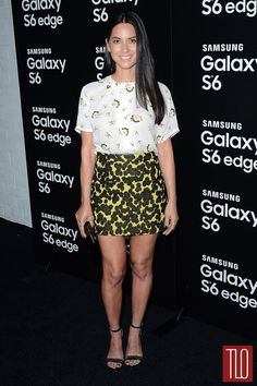 Olivia Munn in an A.L.C. top and skirt paired with Tory Burch sandals, Shylee Rose jewelry, and a JustFab clutch.
