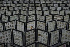 Week of Nov 29 - Dec 5, 2014 A man looks at a collection of stamps Tuesday during the World Youth Stamp Exhibition in Kuala Lumpur. Mohd Firdaus/Zuma Press