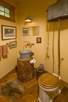 "I am IN LOVE with this bathroom...love the old ""box closet"" toilet....and the bucket sink:)....planning on redoing the hall bathroom, getting ideas....THIS could be done on a budget....other that finding the old toilet....that is going to pose the problem:)"