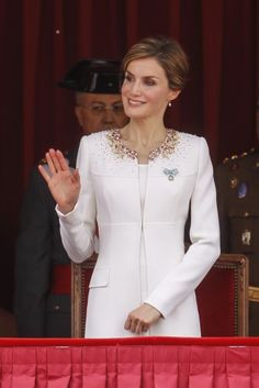 Queen Letizia giving a majestic wave during the ceremony.